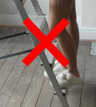 Step ladder wearing slippers- click to enlarge
