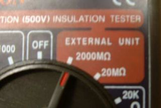 select ohms on multimeter