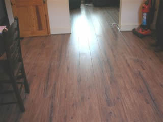 Laminate floor fitting