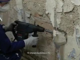 removing plaster from wall