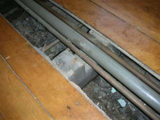 pipes under floor boards