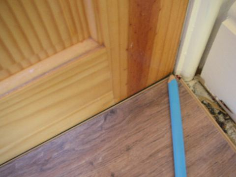 Laminate flooring lay laminate flooring around doors for How to lay laminate flooring through a doorway