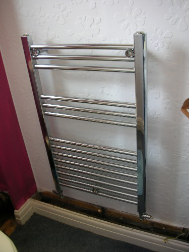 Fix A Towel Radiator To A Wall Central Heating
